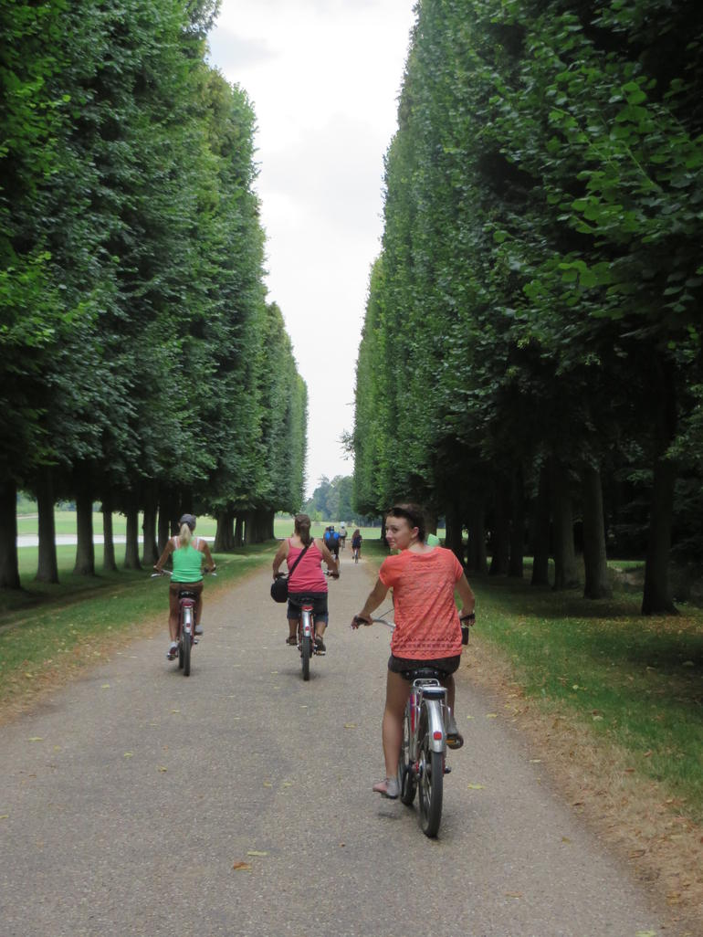 Biking through the gardens at Versailles - Paris