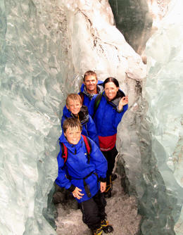 Martin and Natalie Newell with their sons Lachlan and Cameron explore one of the ice tunnels at Franz Josef Glacier as part of the full-day tour. , Natalie N - January 2012