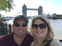 Enjoying the Tower Bridge behind us at the Tower of London. Really great day on tour. , Aly K - June 2016
