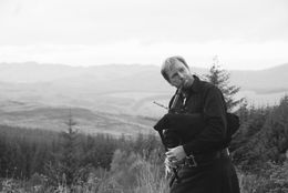 Mac, our tour guide, at our last scenic stop in the Highlands, surprises everyone by breaking out his bagpipe -- very impressive! , Scott R - November 2015