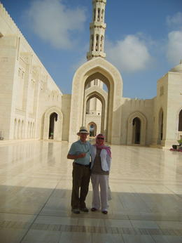 Tour of the mosque -the guide took this photo of us. I had to cover up completely to conform with the traditions. Beautiful place. , ROSALIND N - May 2011