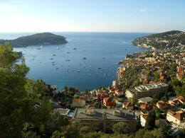 The peninsula of St. Jean Cap Ferrat in the upper left of the photo. The very wealthy live and play on this lovely area of land. Notice the beautiful seaside, neighborhoods and homes along the water. - October 2009