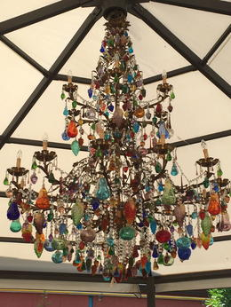 This is the beautiful chandelier hanging in the outdoor garden pavilion at the Murano Glass Factory, comprising handblown fruit, crystals and ornaments in stunning colors. This 'baby' had to be at ... , GAIL E - July 2014