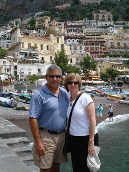 My wife and I pose for a picture while waiting for the boat that will take us along the coastline., David F - July 2008