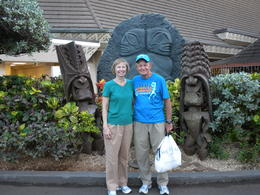 Us by some tiki figures near the entrance , Richard J C - December 2010