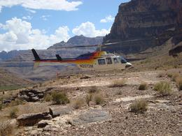 Waiting for our helicopter to arrive to take us back up the canyon ,the previous party taking off, RICHARD L - September 2010