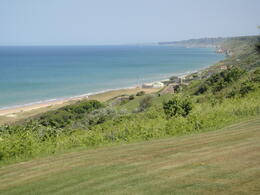 Looking down at Omaha Beach over the dunes at high tide from the American Cemetery. , Bayne S - May 2011