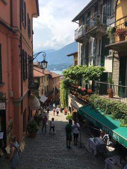 At the top of the steps in a street of Bellagio with Lake Como in the background , Michelle R - September 2016