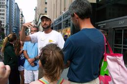 This is JP our tour guide introducting himself outside the entrance to Empire State , Jackie G - September 2012