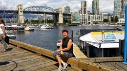 Edie sitting with bridge in background. , Arthur K - June 2014
