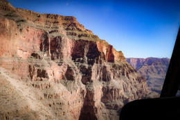 Picture of the west rim of the canyon from inside the helicopter. , Samantha H - September 2017