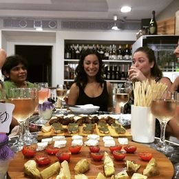 Sampling the different kinds of cheese, wine, etc. so yummy , Jessica B - October 2015