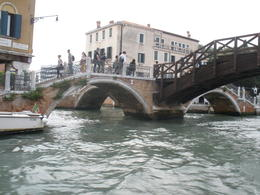 Canal boat tour photo of footbridges in Venice , Ronald R - June 2012