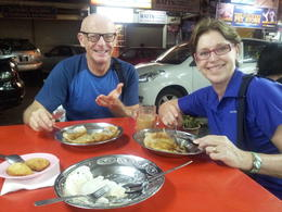 Allison and I eating fermented rice pancakes , Stephen J M - March 2013