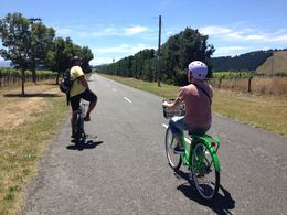 Roxy and our guide, Stuart, cycling through beautiful Martinborough to an olive grove., emmaknock - February 2016
