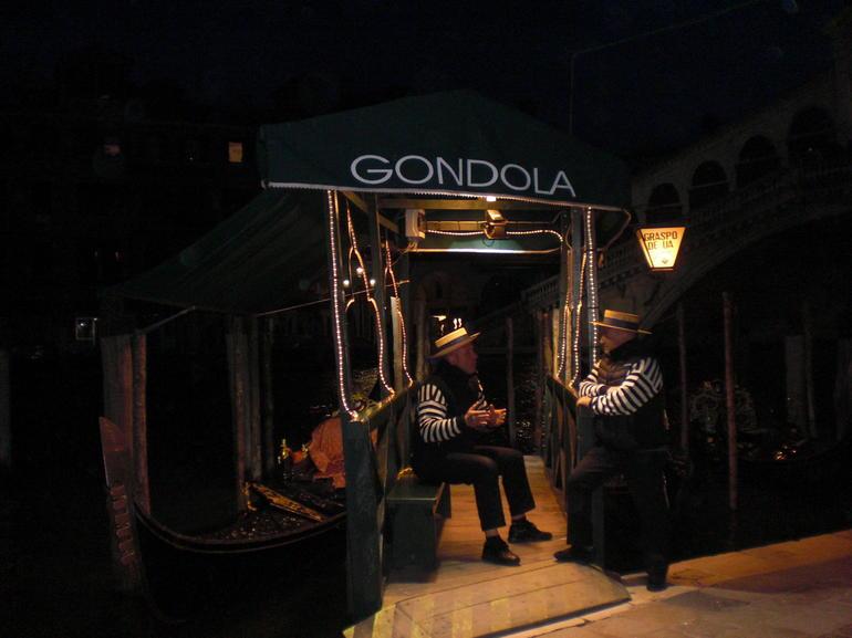 Gondoliers at dusk - Venice