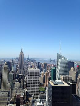 Great picture of the Empire State Building from the Top of the Rock. You can also see Ellis Island. , Debbie M - May 2014