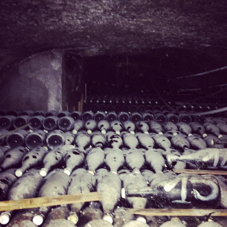 Dusty bottles that are still aging and not ready to be consumed. - Paris