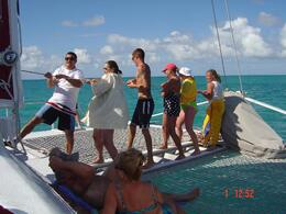 They asked for some females to volunteer to put up the sail and my daughter volunteered. She is the one on the end. The two guys worked on the boat. The other ladies were also passengers that..., Patricia K - February 2008