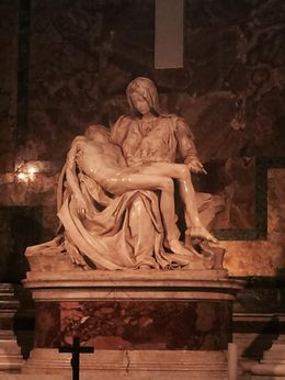 This photo shows one of the highlights of the tour, the Michelangelo statue of Mary holding the body of Jesus. The statue is protected behind plastic, but you can get close enough to see the..., Jeremy P - June 2016