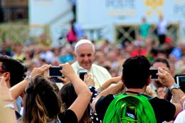 To be close tot he Pope, you have to stay close the fences by which the Pope's mobile passes by , JumpingNorman - September 2014