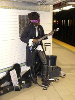 And Boy could he play that guitar. This was a Sunday morning in the subway!! Nice and quiet so we stayed for a couple of songs., Norman M - March 2008