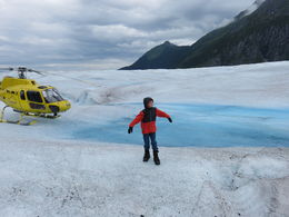 Child enjoying a walk on the glacier near the helicopter , Alan S - July 2016