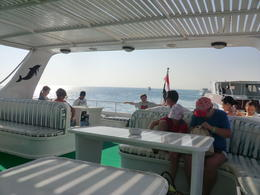 Enjoying the spacious deck on the boat - that's me in the background, basking in the sun! , David E - November 2012
