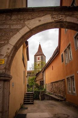 There were so many quaint little alleyways to walk through - this one has a view of one of the towers. , Sandra S - May 2016