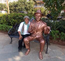 Im with statue of Raj Kapoor who is famous bollywood top actor also see all stars hand print on the footpath. I enjoyed it very much. great photo shots. , Miss R B - January 2014