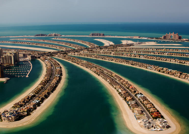 Palm Jumeirah Juts Out From The Dubai Sline Into Persian Gulf Resembling Above A Tree Sprouting Beach