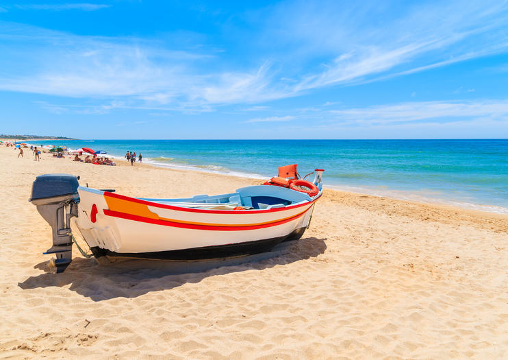 With Its Golden Sands And Sandstone Carved Coves Armacao De Pera Beach Epitomizes The Coastal Beauty Of Portugal S Algarve Backed By A Fishing Village
