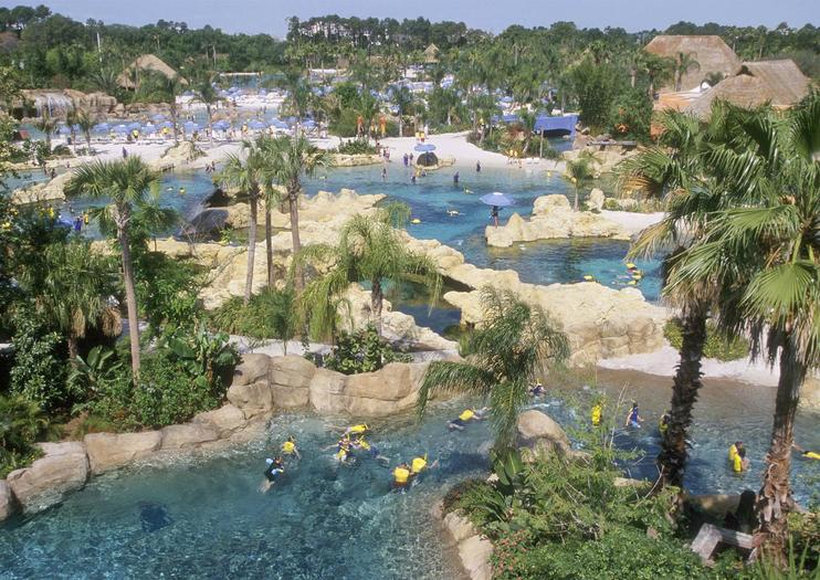 Home To Some Of The Tropical World S Most Charismatic Creatures Discovery Cove Theme Park Features Opportunities For Guests Lounge On White Sand