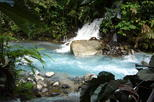 Blue Volcanic River Waterfalls and Hot Springs Mud Bath Adventure in Rincon de la Vieja from Playa Flamingo