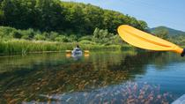 Transparent kayaks on river Gacka
