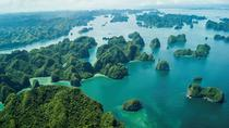 Discovering Halong Bay by Canoe including Private pick up from Airport, Hanoi, Kayaking & Canoeing