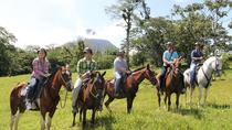Horseback Riding at Arenal Wilberth Stable in front of Arenal Volcano National Park, La Fortuna,...