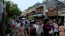 Nanluoguxiang and Local people living Hutong with Courtyard BAR with snacks, Beijing, Food Tours