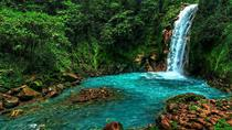Celeste river waterfall and volcano guided rainforest hike and exuberant wildlife watching tour at...