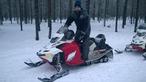 Full-Day Snowmobile Safari including Lunch and Ice Fishing Experience, Rovaniemi, Ski & Snow