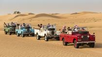 Desert Experience: Dinner and Emirati Activities with Vintage Land Rover Transport from Dubai,...