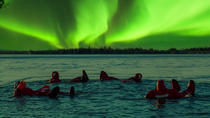 Ice Floating in Forest Lake with Aurora Borealis, Rovaniemi, 4WD, ATV & Off-Road Tours