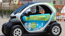 Free Ride Lisbon 6 Hours in an Electric Car with GPS Audio Guide, Lisbon, Self-guided Tours &...