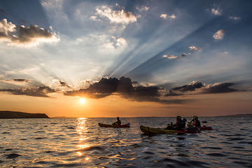 Guided half-day sunset kayaking in...