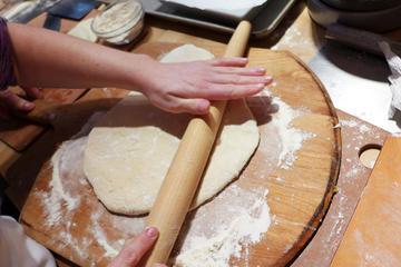 L'arte della preparazione della pizza