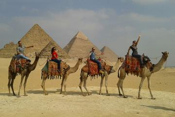 Giza Pyramid Desert Camel ride Trip  during Sunrise or sunset