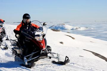 Half-Day Snowmobile Safari including Lunch in Helsinki Archipelago
