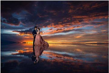 Seasonal Tour: Sunrise  with reflections in the water, Uyuni Salt Flats