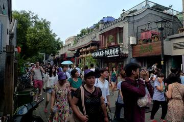 Nanluoguxiang and Local people living  Hutong with Courtyard BAR with snacks