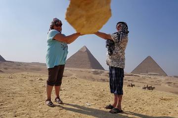 Giza pyramids sphinx camel ride lunch...
